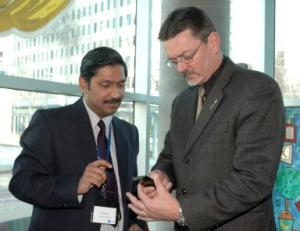 Dr. Kinshuk Demonstrates Cell Phone Technology to Technology Minister Doug Horner